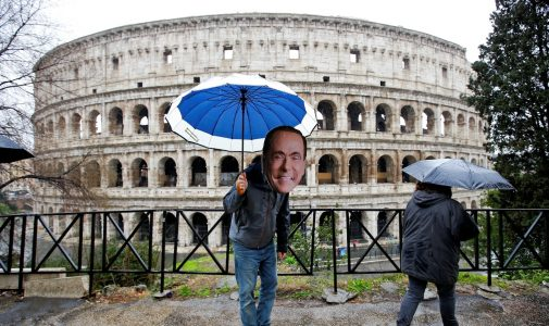 An activist wearing a mask of Forza Italia party leader Silvio Berlusconi poses during a tour, the day after Italy's parliamentary election, in Rome, Italy March 5, 2018. REUTERS/Max Rossi