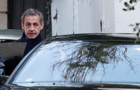 Former French President Nicolas Sarkozy enters his car as he leaves his house in Paris, France, March 21, 2018. REUTERS/Benoit Tessier