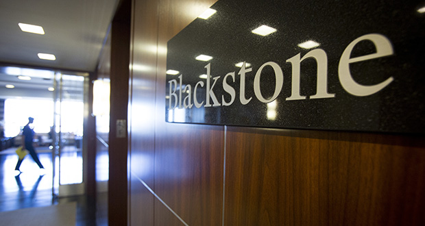 The Blackstone Group LP logo hangs in the company's offices in New York, U.S., on Tuesday, June 4, 2013. Blackstone Group LP, the second-biggest U.S. office landlord, has said it expects strong interest from sovereign-wealth funds for properties it plans to sell starting this year. Photographer: Scott Eells/Bloomberg