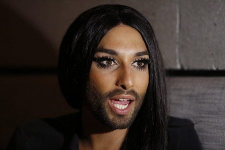 epa04794011 Austrian singer and winner of the 2014 Eurovision Song Contest, Conchita Wurst speaks during a press conference in Tel Aviv, Israel, 11 June 2015. Conchita Wurst was invited to open the 'Tel Aviv Gay Pride Parade 2015' on 12 June. According to organizers, about 180,000 participants are expected, including thousands of tourists from around the world.  EPA/ABIR SULTAN