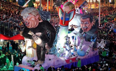 epa06537750 A float of US President Donald J. Trump, Turkish President Recep Tayyip Erdogan and Russian President Vladimir Putin  entitled 'Planet of the Apes' goes through the crowd during the Nice carnival parade, in Nice, France, 17 February 2018. The 134th annual Carnival of Nice will run from 17 February to 03 March. The theme will be 'King of Space'.  EPA/SEBASTIEN NOGIER