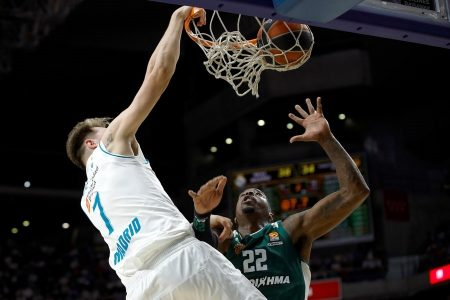 epa06692568 Real Madrid's Slovenian point guard Luka Doncic (L) vies for the ball with Panathinaikos' US center Kenny Gabriel (R) during the basketball Euroleague playoff match between Real Madrid and Panathinaikos Athens at WiZink Center, in Madrid, Spain, 25 April 2018.