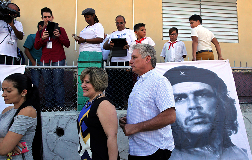 FILE PHOTO: Cuba's First Vice-President Miguel Diaz-Canel and his wife Lis Cuesta stand in line before Diaz-Canel casts his vote during an election of candidates for the national and provincial assemblies, in Santa Clara, Cuba, March 11, 2018. REUTERS/Alejandro Ernesto/Pool/File Photo