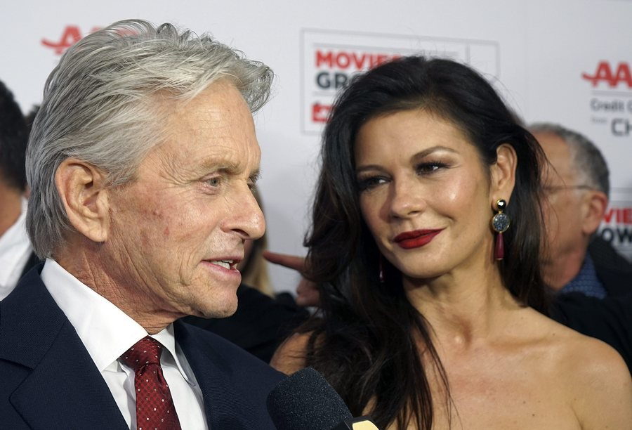 epa05150639 British actress Catherine Zeta-Jones (R) and her husband US actor Michael Douglas arrive for the AARP's 15th Annual Movies For Grownups Awards at the Beverly Wilshire Four Seasons Hotel in Beverly Hills, California, USA, 08 February 2016. EPA/NINA PROMMER