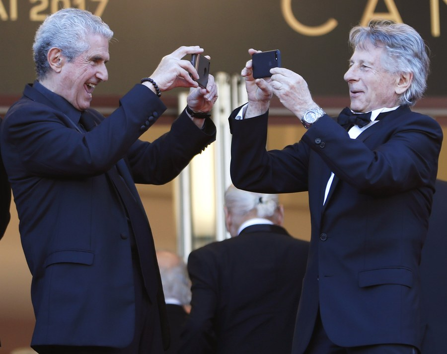 epaselect epa05984918 French director Claude Lelouch (L) and French Polish director Roman Polanski (R) arrive for the 70th Anniversary ceremony during the 70th annual Cannes Film Festival, in Cannes, France, 23 May 2017. The festival runs from 17 to 28 May. EPA/IAN LANGSDON