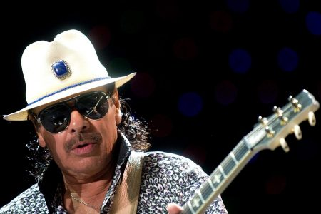 epa06084514 (FILE) Mexican musician Carlos Santana performs at the Papp Laszlo Budapest Sports Arena in Budapest, Hungary, 05 July 2011 (reissued 13 July 2017). Carlos Santana will celebrate his 70th birthday on 20 July 2017.  EPA/PETER KOLLANYI   EDITORIAL USE ONLY