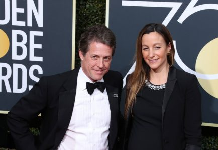 epa06424603 Anna Eberstein (R) and Hugh Grant (L) arrive for the 75th annual Golden Globe Awards ceremony at the Beverly Hilton Hotel in Beverly Hills, California, USA, 07 January 2018.  EPA/MIKE NELSON