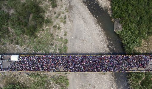 epa06509839 A handout photo made available by the the newspaper La Opinion shows an aerial view of thousands of Venezuelans entering Colombia through the Simon Bolivar international bridge in Cucuta, Colombia, 09 February 2018. Thousands of Venezuelans are trying to enter Colombia through the border crossing of Cucuta on the Simon Bolivar international bridge as new tighter border controls are being implemented.  EPA/Juan Pablo Cohen/ HANDOUT  HANDOUT EDITORIAL USE ONLY/NO SALES