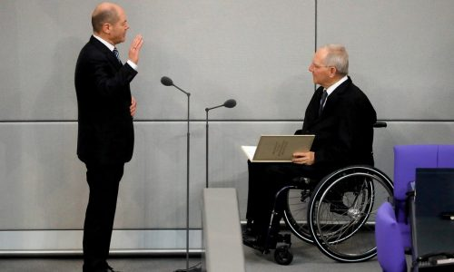 epa06603236 Minister of Finance, Olaf Scholz (L) is sworn in by the President of the German Parliament (Bundestag), Wolfgang Schaeuble (R), on the day of the election of the Federal Chancellor at the Bundestag in Berlin, Germany, 14 March 2018. A coalition of Christian Democratic Union (CDU), Christian Social Union (CSU) and Social Democratic Party (SPD) forms the new German government.  EPA/RONALD WITTEK