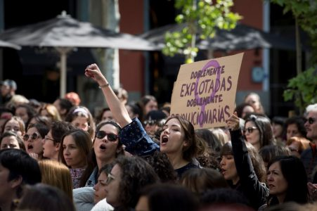 epa06706792 Women shout slogans during a protest against the judicial decision in the so-called La Manada case coinciding with the celebrations on the occasion of the Day of the Autonomous Community of Madrid, in Madrid, Spain, 02 May 2018. The verdict sentenced all five accused to nine years imprisonment for sexual abuse of a young woman during the San Fermin fiestas back in 2016. The sentence has caused national outrage and several protests against the judge's decision to not consider the act as a rape as, according to the sentence, there was no violence. The victim adduced she did not resist in fear the five men would cause her more damage. Feminist groups have called for nationwide protests.  EPA/LUCA PIERGIOVANNI