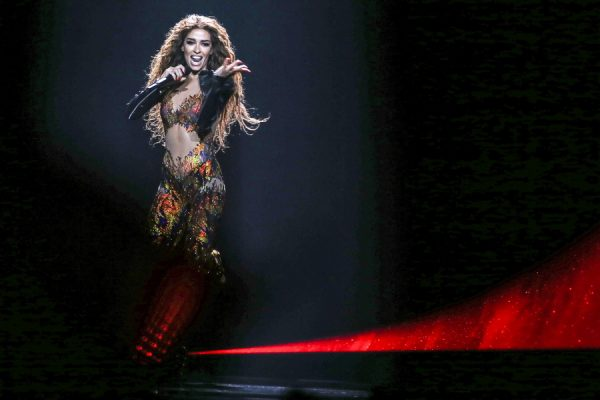 epa06732031 Eleni Foureira representing Cyprus with 'Fuego' perform during the Grand Final of the 63rd annual Eurovision Song Contest (ESC) at the Altice Arena in Lisbon, Portugal, 12 May 2018. Twenty-six finalists are competing to win the ESC 2018.  EPA/JOSE SENA GOULAO