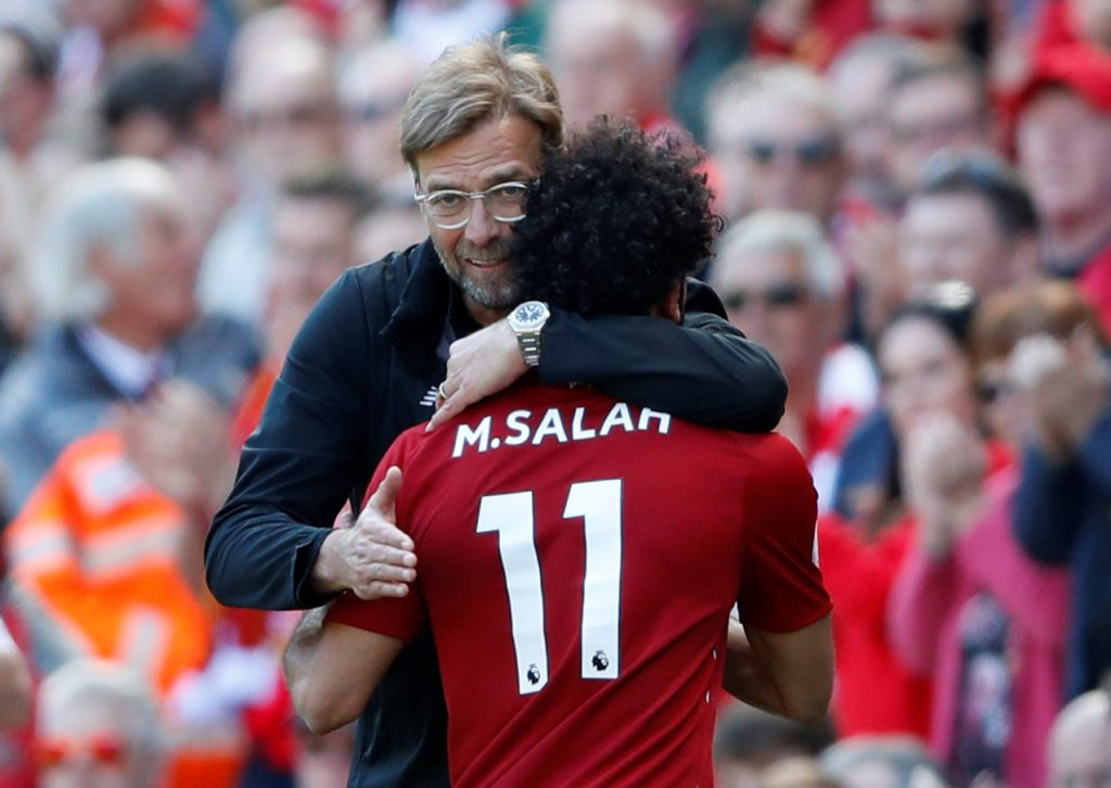 """Soccer Football - Premier League - Liverpool vs Brighton & Hove Albion - Anfield, Liverpool, Britain - May 13, 2018 Liverpool's Mohamed Salah is hugged by manager Juergen Klopp as he is substituted Action Images via Reuters/Carl Recine EDITORIAL USE ONLY. No use with unauthorized audio, video, data, fixture lists, club/league logos or """"live"""" services. Online in-match use limited to 75 images, no video emulation. No use in betting, games or single club/league/player publications. Please contact your account representative for further details."""