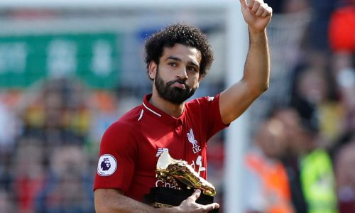 """Soccer Football - Premier League - Liverpool vs Brighton & Hove Albion - Anfield, Liverpool, Britain - May 13, 2018   Liverpool's Mohamed Salah celebrates with the Golden Boot after the match   Action Images via Reuters/Carl Recine    EDITORIAL USE ONLY. No use with unauthorized audio, video, data, fixture lists, club/league logos or """"live"""" services. Online in-match use limited to 75 images, no video emulation. No use in betting, games or single club/league/player publications.  Please contact your account representative for further details."""
