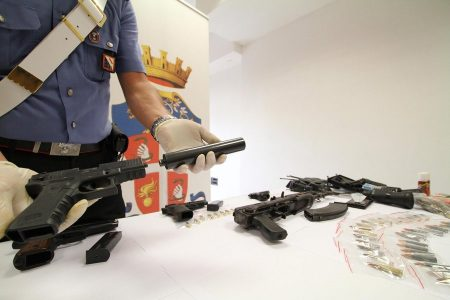 epa03843429 Italian police presents seized weapons, silencers and drugs in Naples, Italy, 30 August 2013. Italian police seized an arsenal of weapons from a family in the Neapolitan Camorra mafia including automatic rifles and other 'weapons materiel', police said. Drugs and radio receivers were also confiscated. The family of five - father, mother and three sons - were arrested.  EPA/CESARE ABBATE
