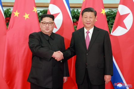 epa06720745 A photo released by the official North Korean Central News Agency (KCNA), the state news agency of North Korea, shows North Korean leader Kim Jong-un (L) shaking hands with Chinese President Xi Jinping (R) during their meeting in Dalian, China, 08 May 2018 (issued 09 May 2018). Kim Jong Un is on an official visit to Dalian City in China from 07 to 08 May for a meeting with Chinese President Xi Jinping.  EPA/KCNA   EDITORIAL USE ONLY