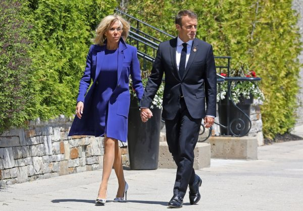 epa06794547 French President Emmanuel Macron and his wife Brigitte Macron walk to the G7 welcoming ceremony in La Malbaie, Quebec, Canada, 08 June 2018. EPA/LUDOVIC MARIN / POOL MAXPPP OUT