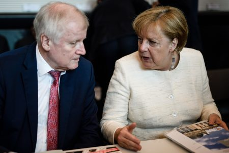 epa06802520 German Interior Minister Horst Seehofer (L) and German Chancellor Angela Merkel sit next to each other during the beginning of CDU/CSU parliamentary group meeting in Berlin, Germany, 12 June 2018. Party members of the parties Christian Democratic Union and Christian Social Union gather for their faction meeting on a regular basis.  EPA/CLEMENS BILAN