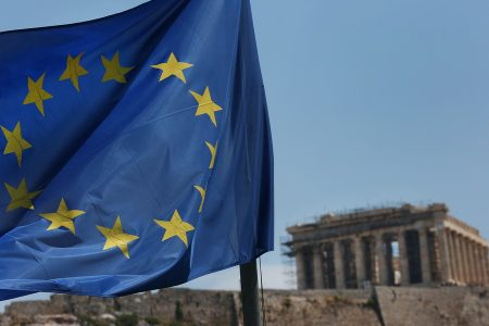 epa06829818 A flag of the European Union flies on the Acropolis hill, across the Parthenon, in Athens, Greece, 22 June 2018. The Eurogroup ministers reached an agreement in principle on the size of the last loan tranche to Greece and debt relief measure, early on Friday morning. Eurogroup ministers agreed that the final loan tranche to Greece will total 15 billion euros. In addition a ten-year extension was granted for the repayment of EFSF loans, with a ten-year grace period.  EPA/ORESTIS PANAGIOTOU