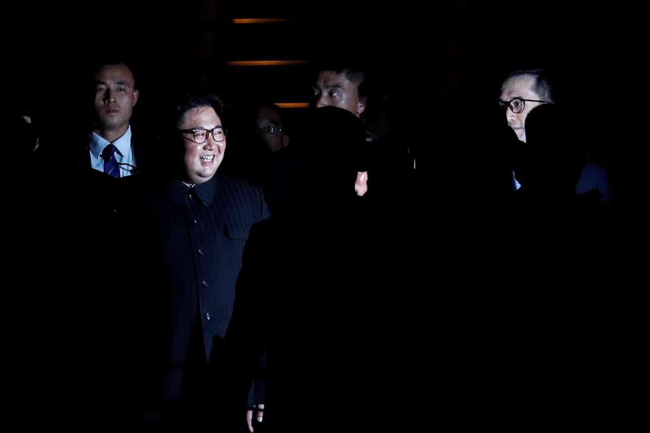 Ο Κιμ ευδιάθετος (REUTERS/Tyrone Siu)
