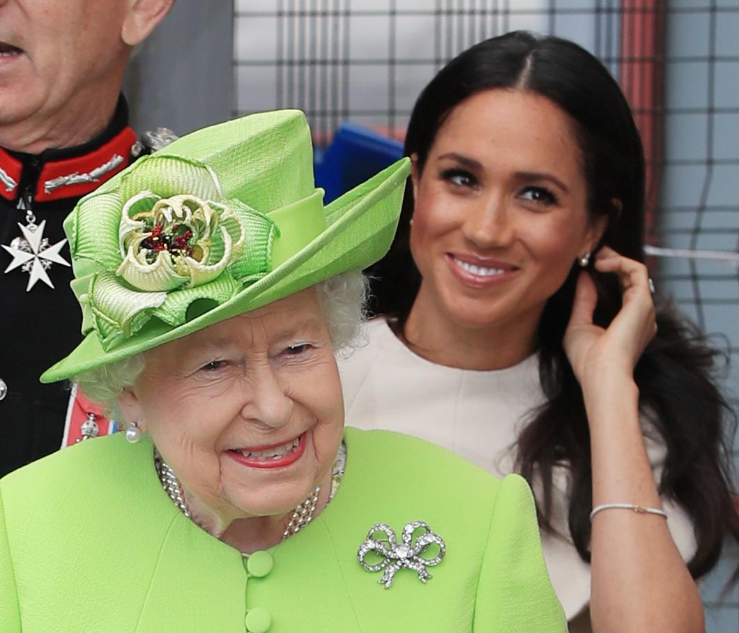 Britain's Queen Elizabeth and Meghan, the Duchess of Sussex, arrive in Runcorn, June 14, 2018. Peter Byrne/Pool via Reuters