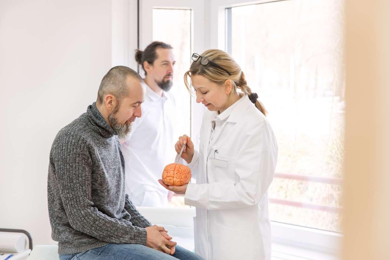 neurologist is showing a male patient_588146372