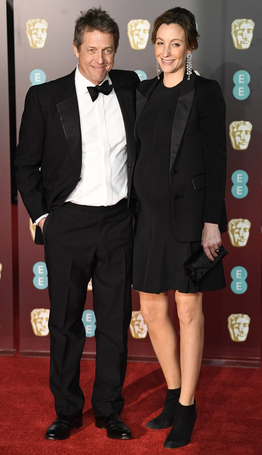 epa06540825 British actor Hugh Grant (L) and producer Anna Eberstein (R) arrive ahead of the 71st annual British Academy Film Awards at the Royal Albert Hall in London, Britain, 18 February 2018. The ceremony is hosted by the British Academy of Film and Television Arts (BAFTA). EPA/NEIL HALL