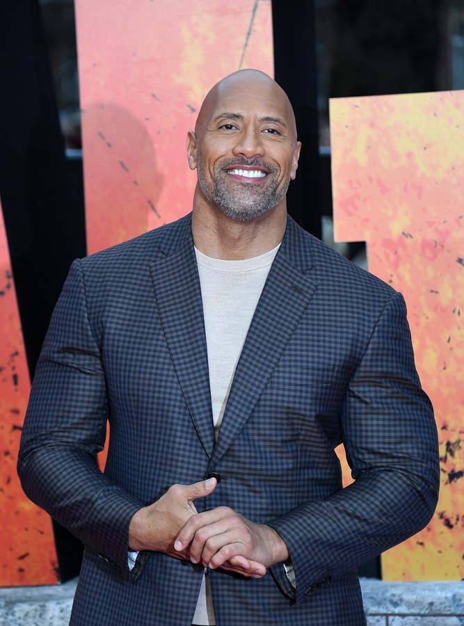 epa06662056 US actor Dwayne Johnson poses for photographs on the red carpet during the European film premiere of Rampage at Leicester Square in London, Britain, 11 April 2018. The movie opens across many European theaters on 12 April. EPA/ANDY RAIN