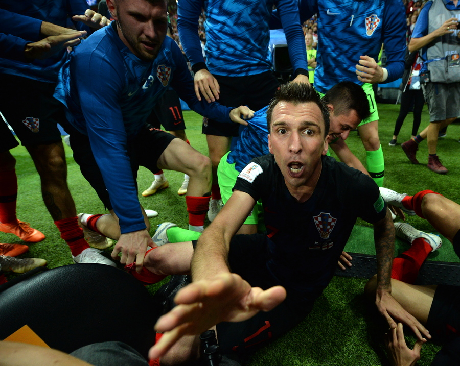 epa06881957 Mario Mandzukic of Croatia celebrates scoring the 2-1 lead during the FIFA World Cup 2018 semi final soccer match between Croatia and England in Moscow, Russia, 11 July 2018. (RESTRICTIONS APPLY: Editorial Use Only, not used in association with any commercial entity - Images must not be used in any form of alert service or push service of any kind including via mobile alert services, downloads to mobile devices or MMS messaging - Images must appear as still images and must not emulate match action video footage - No alteration is made to, and no text or image is superimposed over, any published image which: (a) intentionally obscures or removes a sponsor identification image; or (b) adds or overlays the commercial identification of any third party which is not officially associated with the FIFA World Cup) EPA/PETER POWELL EDITORIAL USE ONLY
