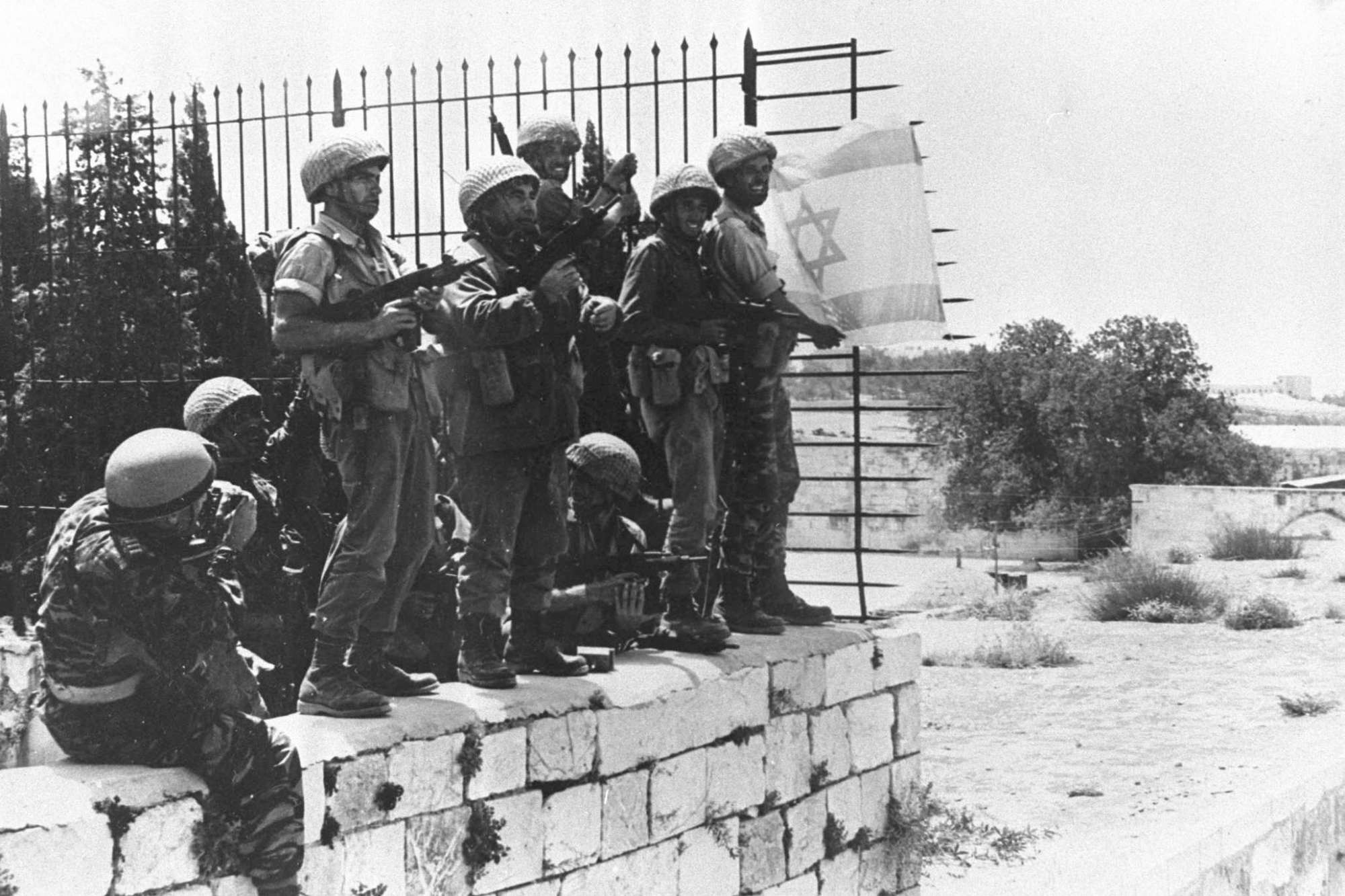 Israeli soldiers raise the Israeli flag over the Western Wall June 7,1967 alongside the Temple Mount in Jerusalem, Israel on the day of its capture from Jordanian forces in the June 1967 Middle East War. (Photo by Newsmakers)