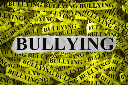 Torn pieces of paper with the word Bullying. _406877341sm