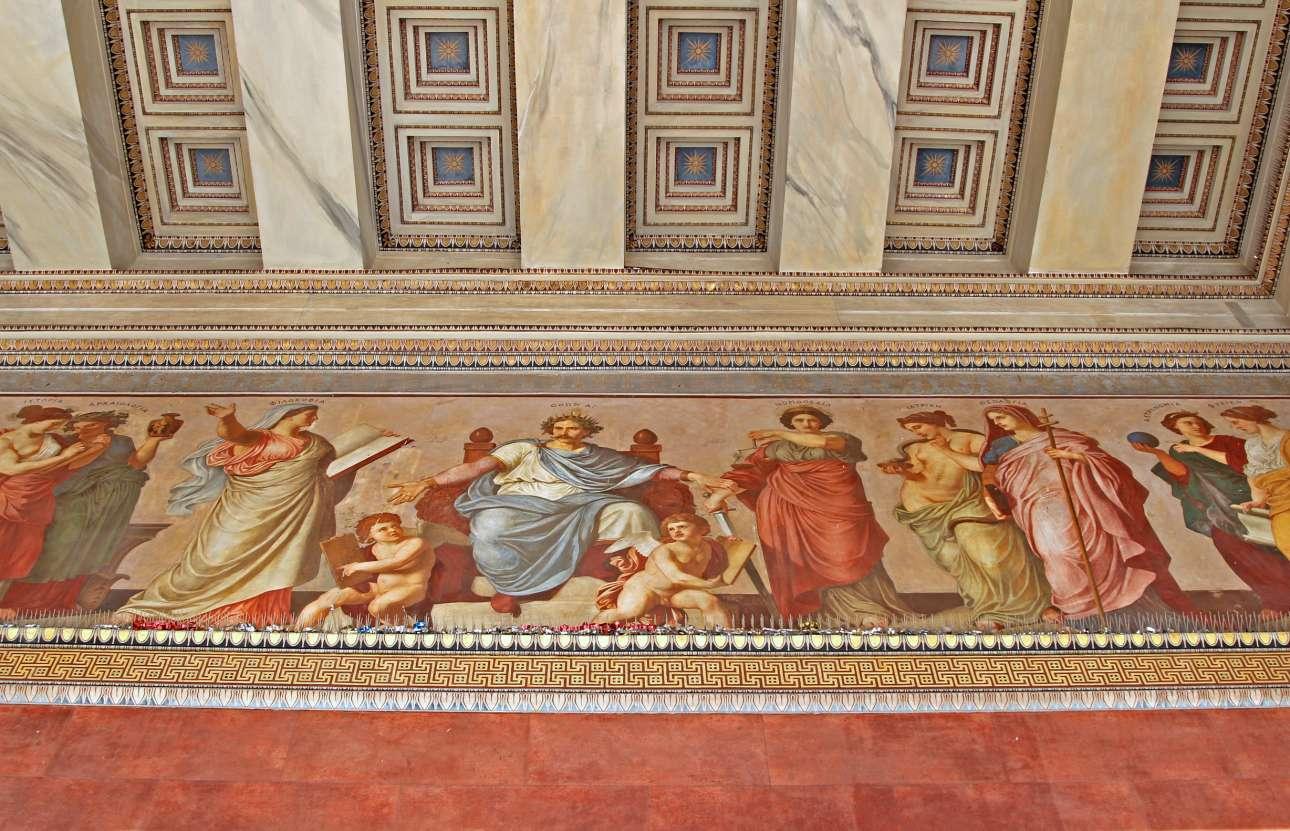 Η εντυπωσιακή τοιχογραφία πάνω από την είσοδο του Πανεπιστημίου Αθηνών